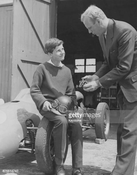Dutch racing driver Rob Slotemaker uses a model car to explain the steering operation to his protege 12yearold Wim Loos at the new 'Skid Patch' of...