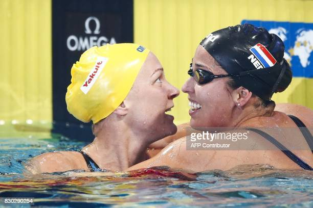 Dutch Ranomi Kromowidjojo and Swedish Sarah Sjostrom react after the 100 metres free wave event during the 2017 FINA World Cup Series in Eindhoven on...