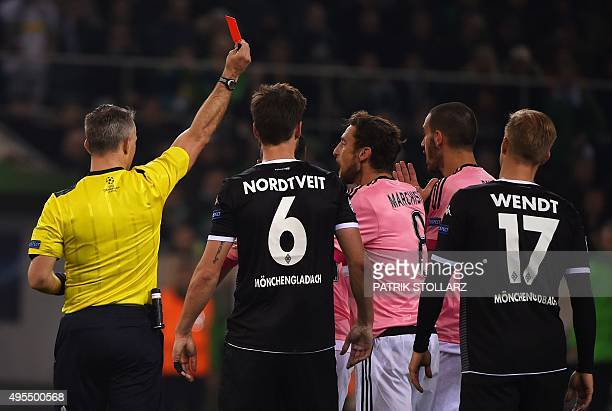 Dutch referee Bjoern Kuipers shows the red card to Juventus' Brazilian midfielder Hernanes during the UEFA Champions League Group D football match...