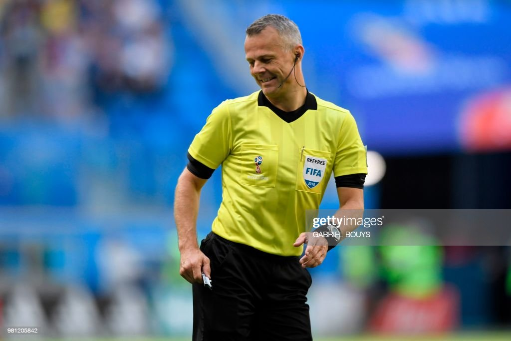 Dutch referee Bjorn Kuipers gestures during the Russia 2018 World Cup Group E football match between Brazil and Costa Rica at the Saint Petersburg Stadium in Saint Petersburg on June 22, 2018. (Photo by GABRIEL BOUYS / AFP) / RESTRICTED