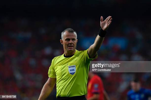 Dutch referee Bjorn Kuipers gestures during the World Cup 2018 qualifier football match Spain vs Italy at the Santiago Bernabeu stadium in Madrid on...