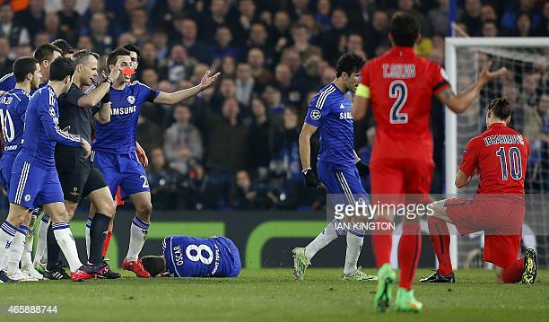Dutch referee Bjorn Kuipers gives the red card to Paris SaintGermain's Swedish forward Zlatan Ibrahimovic following a clash with Chelsea's Brazilian...