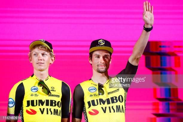 Dutch rider Koen Bouwman and Slovenian rider Primoz Roglic, both of Team Jumbo - Visma pose during the team presentation of the upcoming 2019 Giro...
