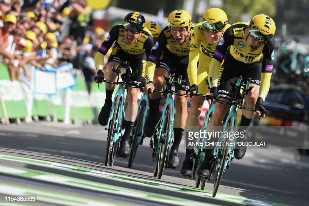 Dutch rider Mike Teunissen wearing his overall leader's yellow jersey and teammates of Netherlands' Jumbo-Visma cycling team sprint to win on the...