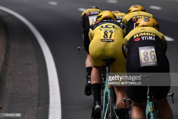 Dutch rider Mike Teunissen wearing the overall leader's yellow jersey and teammates of Netherlands' Jumbo-Visma cycling team compete in the second...