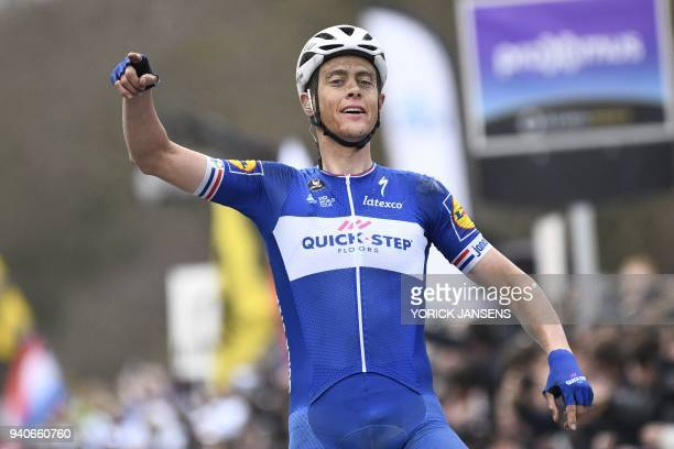 Dutch rider Niki Terpstra of team Quick-Step Floors celebrates as he crosses the finish line to win the 102nd edition of the 'Ronde van Vlaanderen -...