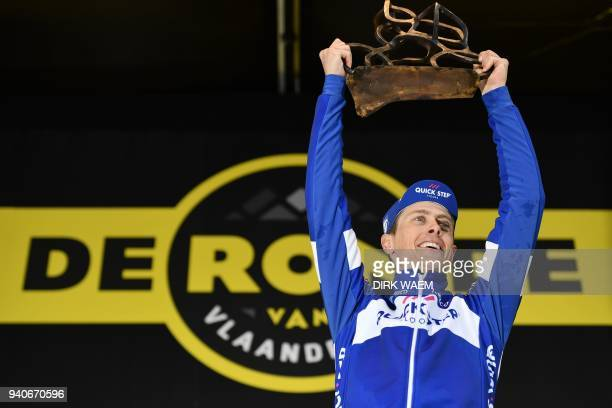 Dutch rider Niki Terpstra of Team Quick-Step Floors celebrates on the podium with his trophy after winning the 102nd edition of the 'Ronde van...