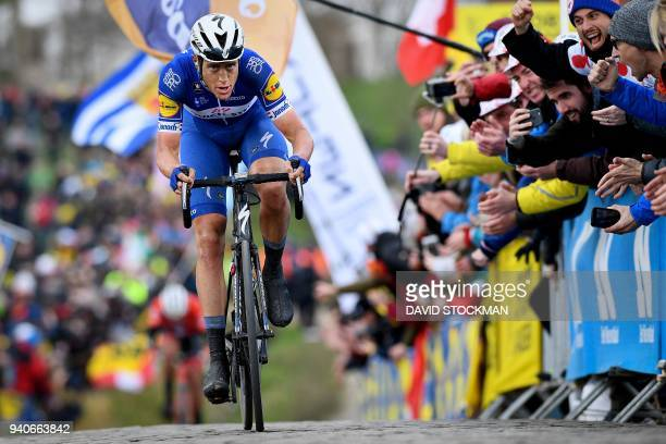 TOPSHOT Dutch rider Niki Terpstra of team QuickStep Floors pedals on the Paterberg hill in Kluisbergen on his way to winning the 102nd edition of the...