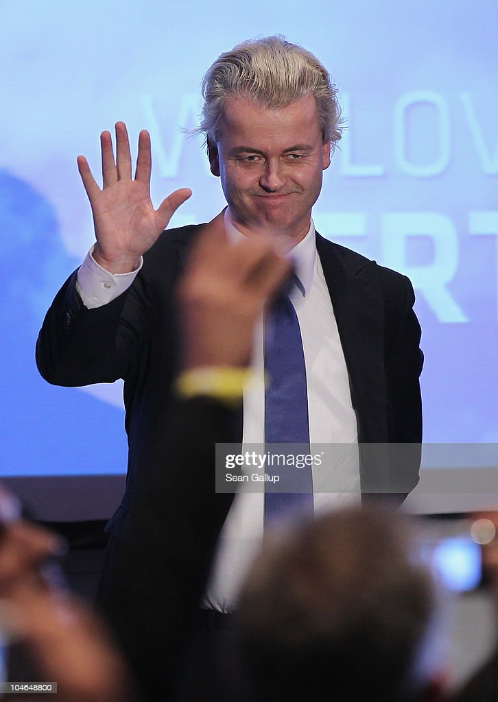 Dutch right-wing politician Geert Wilders waves to supportersafter speaking on October 2, 2010 in Berlin, Germany. Wilders came on the invitation of German renegade former Christian Democrat (CDU) Rene Stadtkewitz, an outspoken Islam critic, to speak to approximately 500 supporters in Berlin. Wilders is seeking to create an international alliance of critics of Islam, called the 'International Freedom Alliance,' in Germany, France, the United Kingdom, Switzerland, Denmark, the United States and the Netherlands.