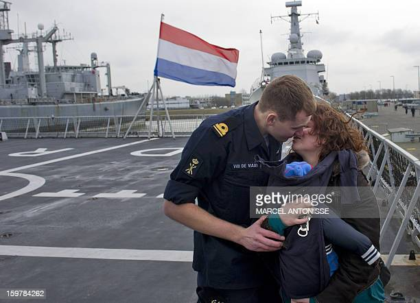 A Dutch Royal Navy's crew member of the vessel 'HrMs De Ruyter' says farewell to a loved one on January 20 2013 at Den Helder harbor near Amsterdam...
