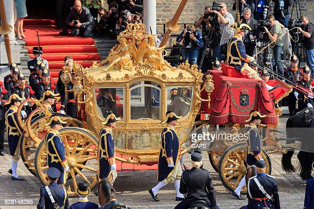 dutch royals arriving on binnenhof during prinsjesdag in the hague - prinsjesdag stock photos and pictures