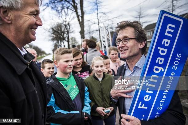 "Dutch scientist Bernard Lucas ""Ben"" Feringa , the 2016's Nobel Peace Prize laureate in Chemistry, attends a ceremony to unveil the plaque of a street..."