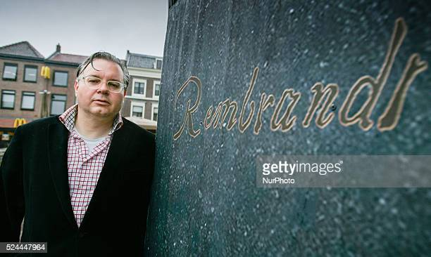 Dutch sculptor laureate Jeroen Spijker is seen with his concept for a Rembrandt statue.