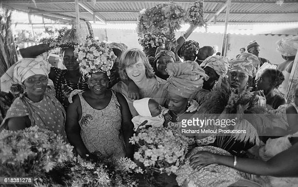 Dutch singer Dave Levenbach poses with a group of Senegalese women in Dakar