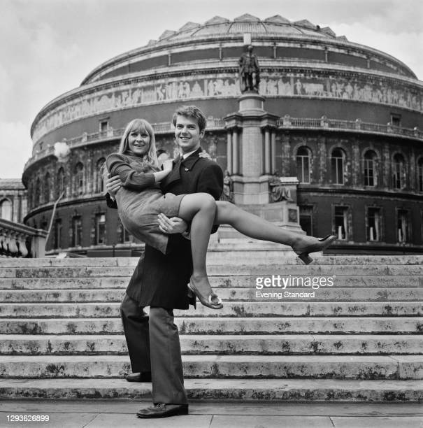 Dutch singer Ronnie Tober carrying Belgian singer Claude Lombard outside the Royal Albert Hall in London, UK, during the 1968 Eurovision Song...