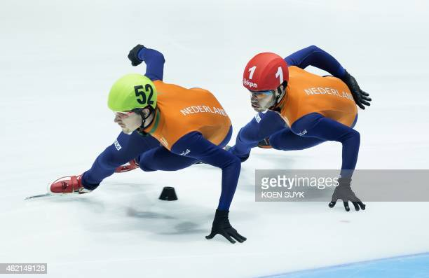 Dutch skaters Freek van der Wart and Sjinkie Knegt skate past during the 1000 meter event on the final day of the ISU European Short Track Speed...