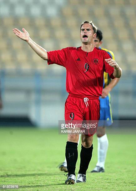 Dutch soccer star and Qatar's AlRayan Club player Frank De Boer reacts 19 September 2004 during a match against AlIttihad club in preparation for the...