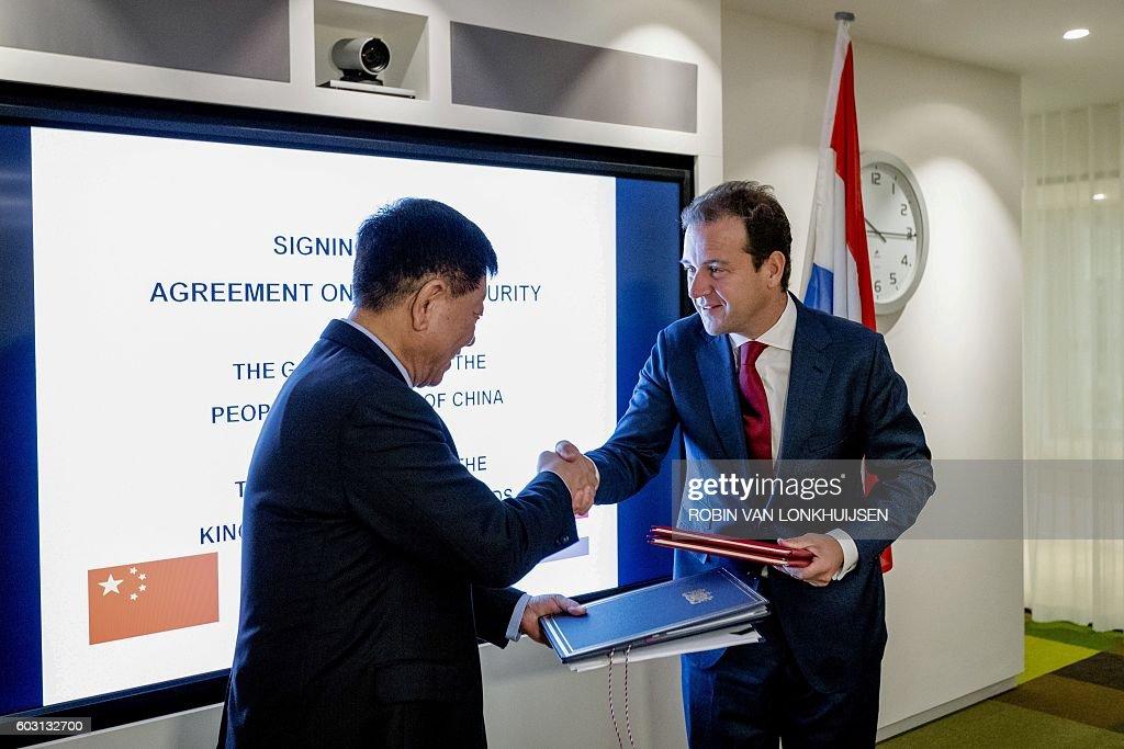 Dutch Social Affairs Minister Lodewijk Asscher R Shakes Hands With