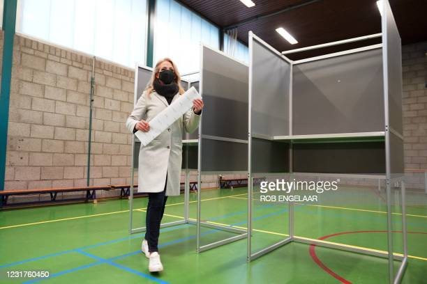 Dutch Socialist party leader Lilian Marijnissen votes in the House of Representatives elections at the De Korenaer primary school polling station In...
