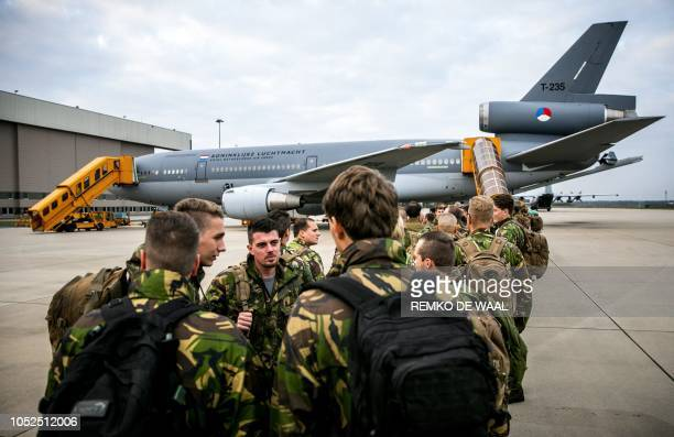 Dutch soldiers depart with a KDC10 tank and transport device from Eindhoven Airport in Eindhoven in The Netherlands on October 19 2018 to participate...