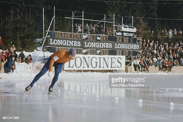 Dutch speed skater Eddy Verheijen pictured in competition in the 1969 European Speed Skating Championships event on an ice covered long track in...