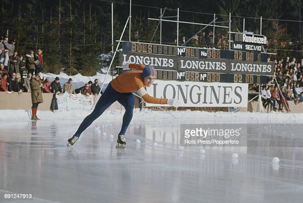 Dutch speed skater Jan Bols pictured in competition in the 1969 European Speed Skating Championships event on an ice covered long track in Inzell...