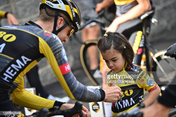Dutch Steven Kruijswijk of Team Jumbo-Visma signs an autographes for a young fan during the second rest day of the 108th edition of the Tour de...