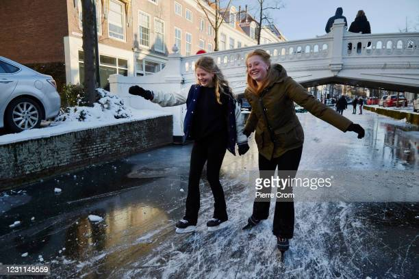 Dutch students ice skate on the frozen canals on February 13, 2021 in Delft, Netherlands. Parts of central and northern Europe and Britain have...