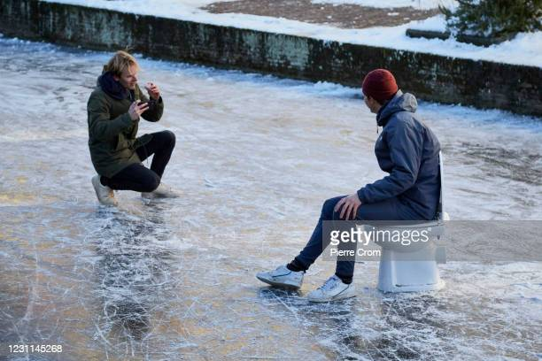 Dutch students take photos on the frozen canals on February 13, 2021 in Delft, Netherlands. Parts of central and northern Europe and Britain have...