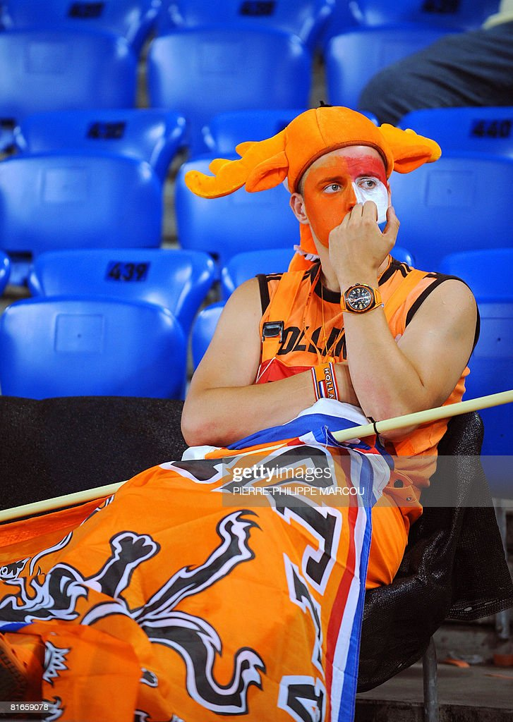 A Dutch supporter looks dejected after Russia won the Euro 2008 Championships quarter-final football match the Netherlands vs. Russia on June 21, 2008 at St. Jakob-Park in Basel. Russia won 3-1.