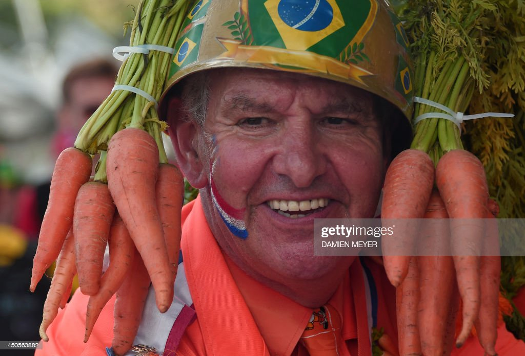 A Dutch supporter smiles before a Group B football match between Spain and the Netherlands at the Fonte Nova Arena in Salvador during the 2014 FIFA World Cup on June 13, 2014.