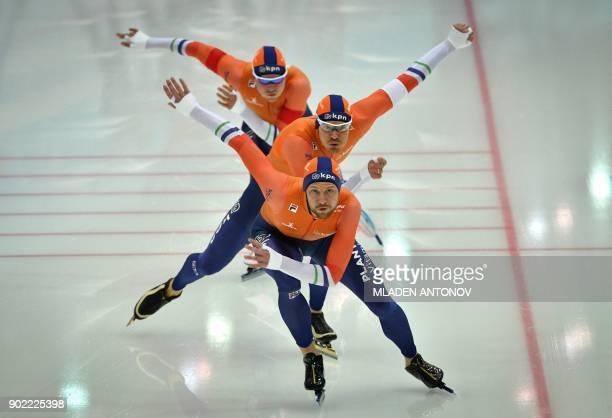 TOPSHOT Dutch team members Michel Mulder Hein Otterspeer and Koen Verweij skate during the men's team sprint men of the European Speed Skating...