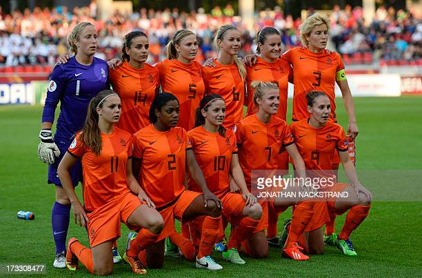 Dutch team pose for the team photo prior to the UEFA Women's European Championship Euro 2013 group B football match Germany vs Netherlands on July 11...