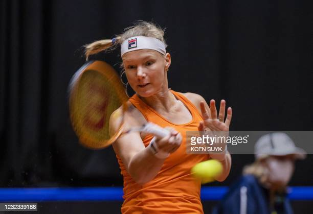 Dutch tennis player Kiki Bertens returns the ball against China's Xinyu Wang in the Billy Jean King Cup tennis Play-off in Den Bosch on April 16,...