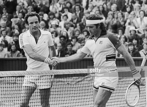 Dutch tennis player Tom Okker shakes hands with Argentina's Guillermo Vilas, after beating him in the mens' singles on centre court at Wimbledon,...