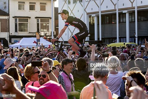 3fe9885bb Dutch Tom Dumoulin of Giant Alpecin team stand on his bike during the team  presentation for
