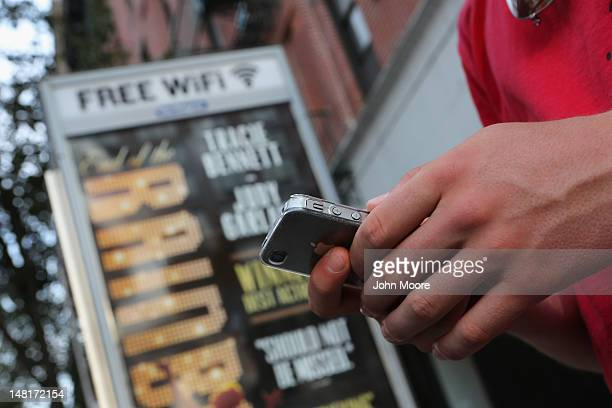 Dutch tourist Bas Derksen surfs the internet while at a free WiFi hotspot on July 11 2012 in Manhattan New York City New York City launched a pilot...