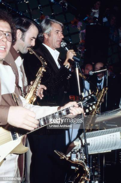 Dutch TV entertainer Rudi Carrell performing at an evening event Germany 1970s