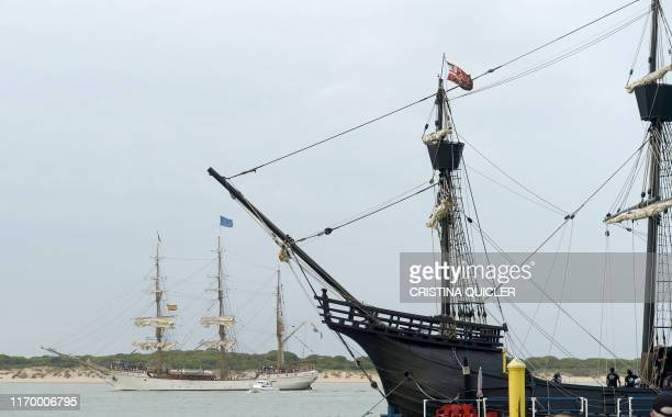 Dutch vessel Europa sets sail to Chile beside a replica of Ferdinand Magellan's ship the Nao Victoria along the Bajo Guia beach in the Guadalquivir...