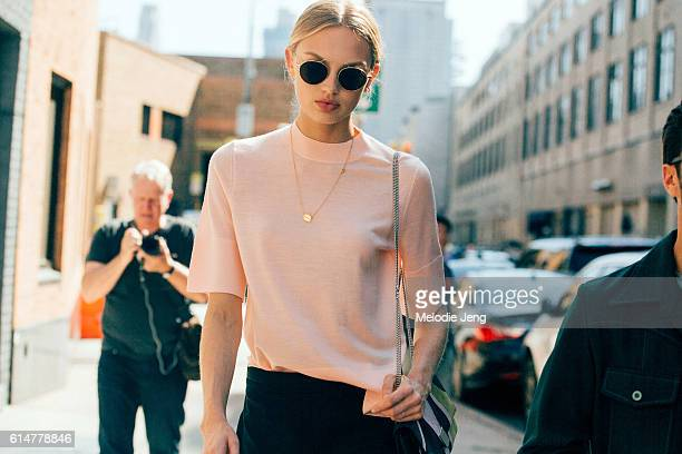 Dutch Victoria's Secret Angel model Romee Strijd attends the Boss Women show in a pink sweater at Skylight Clarkson Sq on September 14 2016 in New...