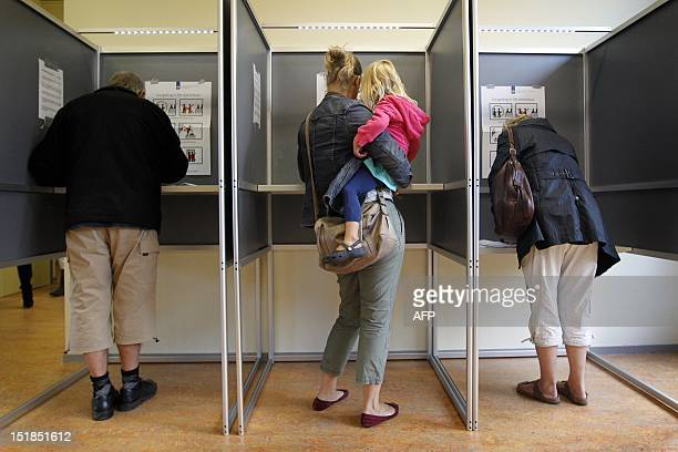 Dutch vote in parliamentary elections at a polling station in Boxmeer on September 12 2012 The Netherlands voted in crunch polls today seen as a...