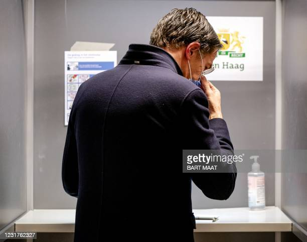 Dutch VVD's incumbent Prime Minister Mark Rutte arrives to cast his vote in the 2021 Dutch general elections in the primary school De Schoolteachers...