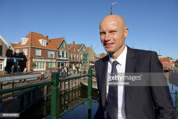 Dutch water ambassador Henk Ovink stands in front of the hightech dique at the historical harbour of Spakenburg Netherlands 6 November 2017 The super...