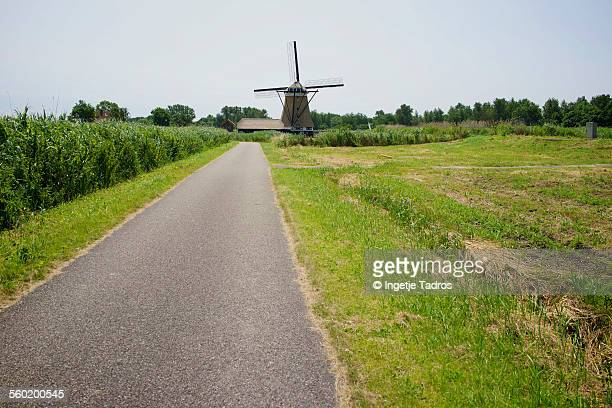 Dutch windmill along a bycicle path