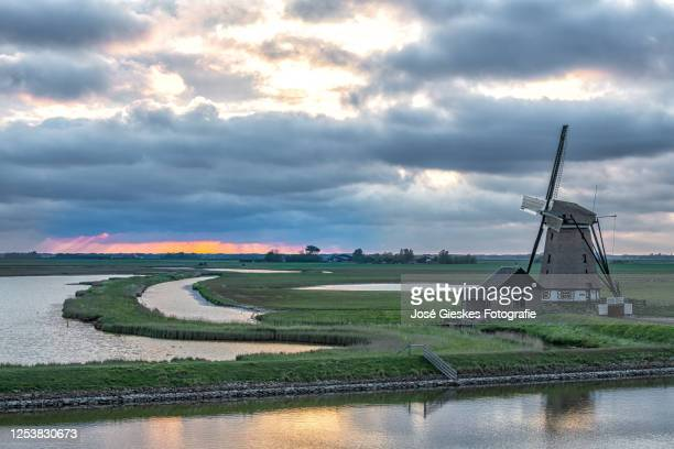 dutch windmill on texel - zonsondergang stock pictures, royalty-free photos & images