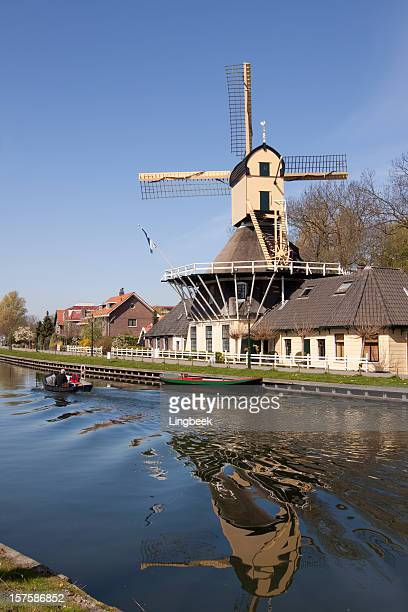 dutch windmill - traditional windmill stock photos and pictures