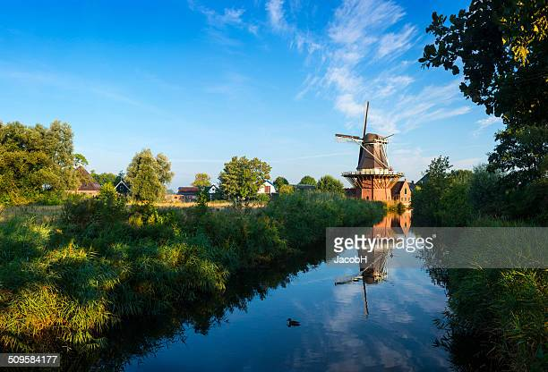dutch windmill - old windmill stock photos and pictures