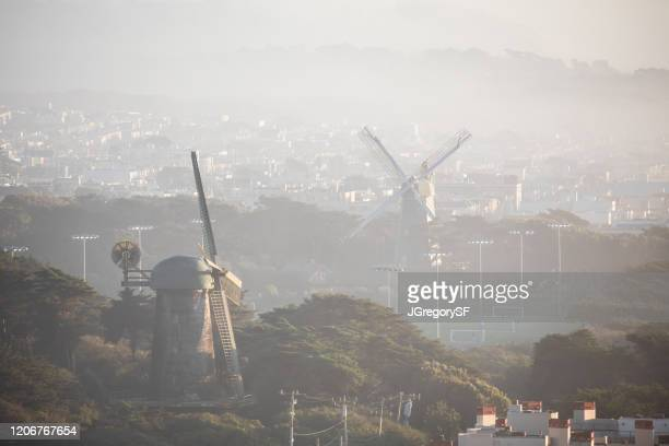 dutch windmills in san francisco golden gate park - aerial view - wind power fog backgrounds - sanduíche stock pictures, royalty-free photos & images