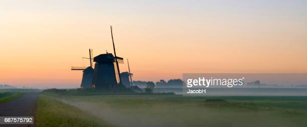 dutch windmills - old windmill stock photos and pictures