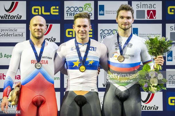 Dutch winner Harrie Lavreysen Matthijs Buchli and Denis Dmitriev pose on the podifum for the honoring of the keirin final during the European Track...